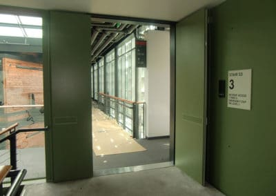 Federal Center South-Seattle, WA. Factory Painted Doors, matching inserts in exit devices